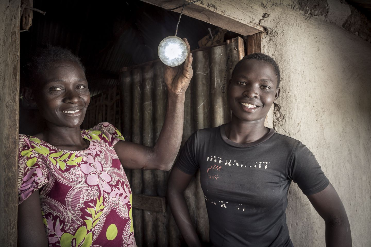 How do grid and off-grid systems enhance or restrict gender equality?
